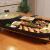 大きいサイズの韓国式家庭用電気ストーブの焼肉機のグリルの多機能の電熱のグリルの鉄板はニュースをあぶって皿を焼きます商用のオシドリのしゃぶしゃぶは一体の鍋を燃やしますオシドリの一体の鍋